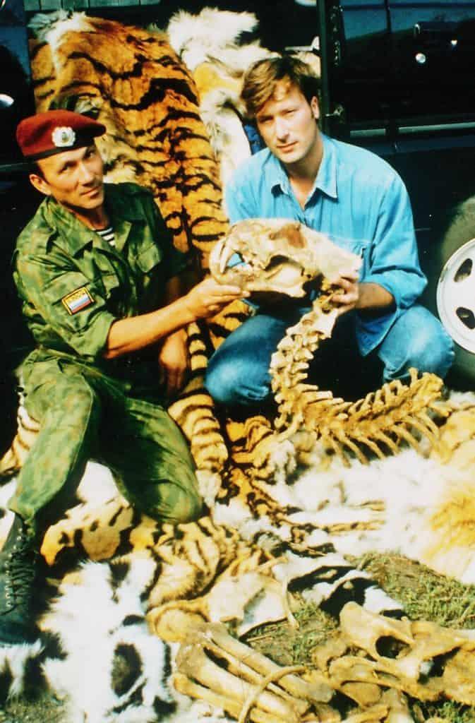 Paul with anti-poaching brigade captain examining tiger parts. Photo. P.Formenko